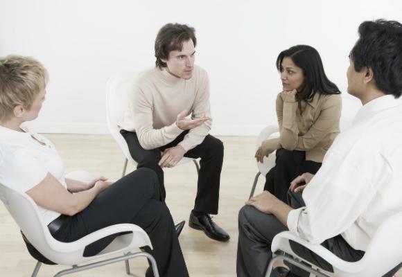 seated-people-talking-3381